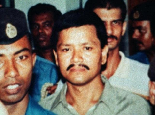 This undated picture shows Anup Kumar Chetia (C), leader of the outlawed United Liberation Front of Assam (ULFA), surrounded by Bangladeshi police as he comes at Dhaka's court. Chetia, an insurgent leader, who was arrested in Bangladesh in 1997, is convicted by a Dhaka court and sentenced to three years in prison and a fine of 5,000 taka for illegal possession of foregin currencies from 16 countries.