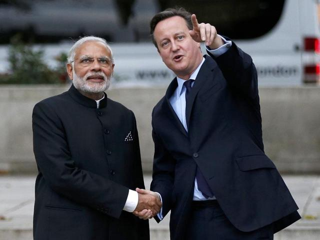 Britain's Prime Minister David Cameron and India's Prime Minister Narendra Modi watch a flypast by the Royal Air Force Red Arrows display team in Parliament square in London.