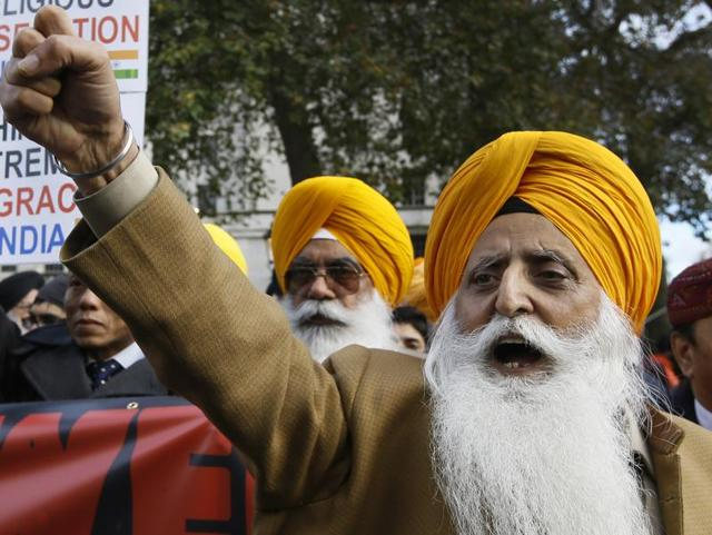 Protestors against the visit of Prime Minister Narendra Modi demonstrate, in London.