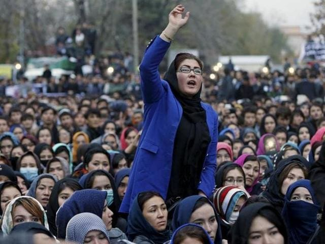 Women chat slogans during a protest against the killing of seven people from the Hazara community in Kabul.