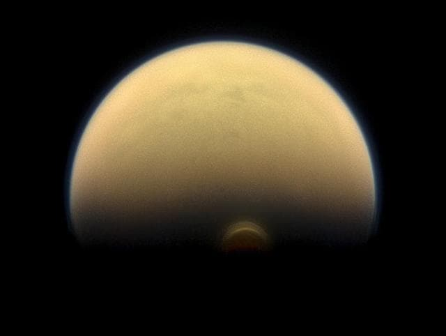 A view of Titan's south polar region, revealing the immense polar vortex cloud that is forming there. Credit: NASA/JPL-Caltech/Space Science Institute
