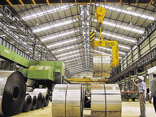 Employees work inside a steel factory in Agartala, capital of Tripura. Indian manufacturing growth cooled in June after a surge in activity the prior month, mainly due to slowing production and rapidly easing input price pressures.