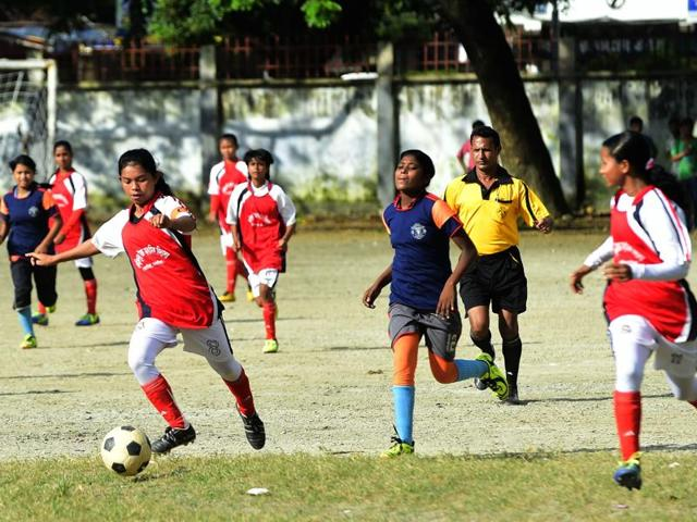 In this photograph taken on September 14, 2015, Bangladesh's Kolsindur high school football team captain Maria Manda (C) controls the ball during a match in Dhaka. More than a dozen of Kolsindur's players have already played on the national girls' team, among them 12-year-old Tahura Khatun, a diminutive striker nicknamed the