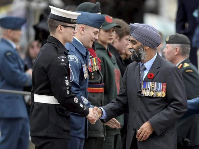 Defense Minister Harjit Singh Sajjan shakes hands with a cadet during the Remembrance Day ceremony in Ottawa on Wednesday.