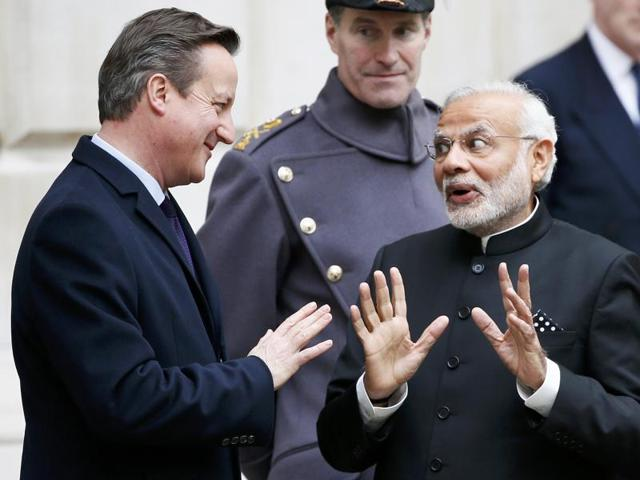 Indian Prime Minister Narendra Modi chats with Britain's Prime Minister David Cameron after the ceremonial welcome during his official visit in London.
