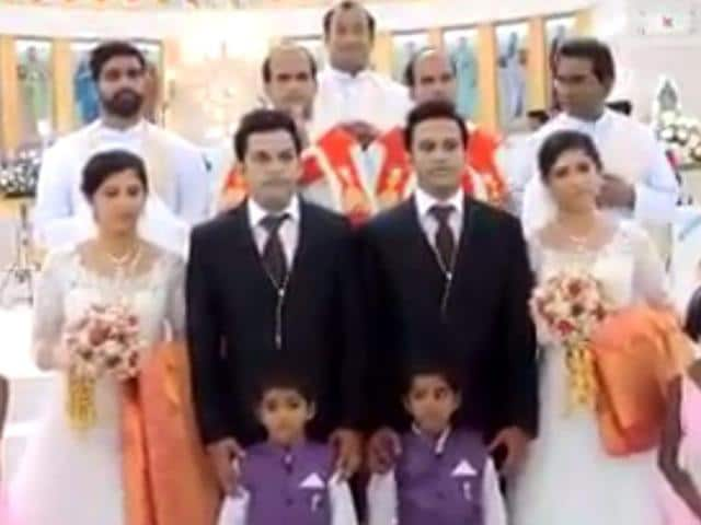 Screengrab of the twin couples who got married in a ceremony officiated by a pair of twin priests, in Kerala.