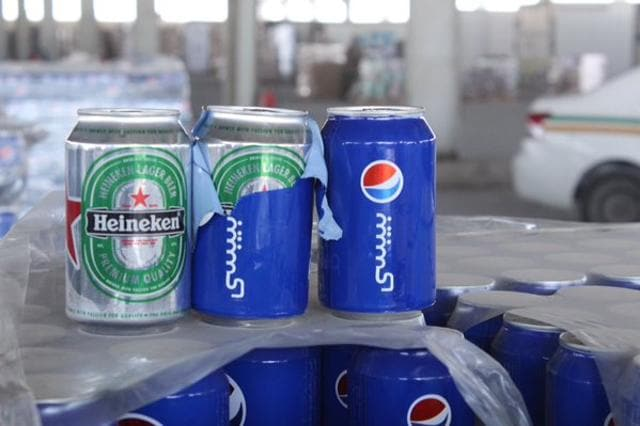 A photograph posted on Twitter by Saudi Arabian customs shows how beer cans were disguised as Pepsi Cola.