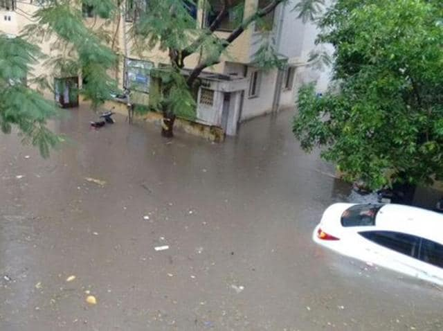 Scene from a water-logged Chennai street .