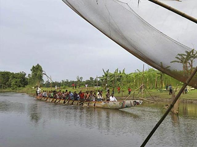 Participants paddle a country boat during a traditional boat race at Dashiachora, in Kurigram enclaves, Bangladesh. Bangladesh and India exchanged enclaves in July, where the two neighbouring countries now implement the Land Boundary Agreement in line with a deal signed in 1974.