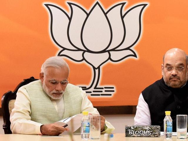 Prime Minister Narendra Modi with BJP president Amit Shah at the party's parliamentary board meeting in Delhi after they lost the Bihar elections on Sunday.