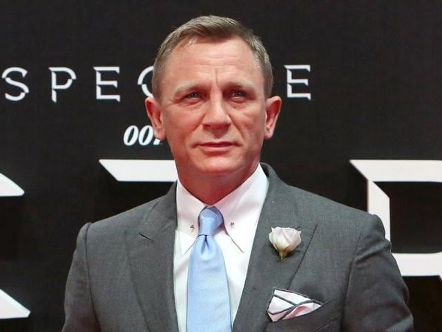 Sony released a new poster on Thursday of Spectre where Daniel Craig is seen donning a white tuxedo with a gun.
