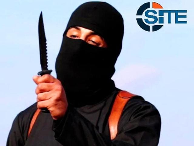 A masked, black-clad militant, who had been identified as a Briton named Mohammed Emwazi, brandishes a knife in this still image from a 2014 video obtained from SITE Intel Group.