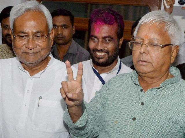 Bihar chief minister Nitish Kumar and RJD chief Lalu Prasad show victory sign after Mahagathbandhan's (Grand Alliance) victory in Bihar assembly elections at RJD office in Patna.