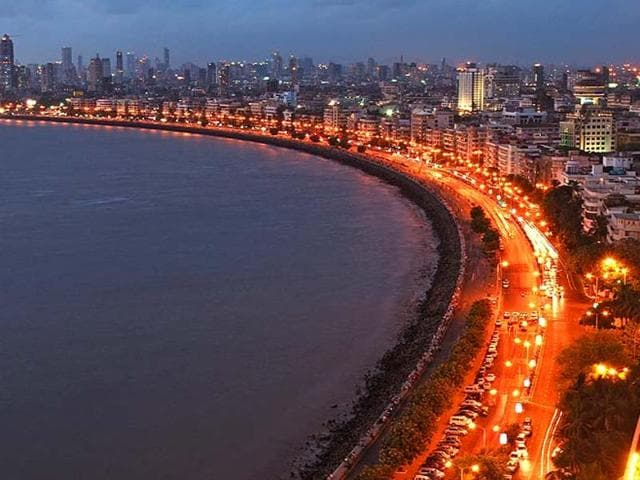 """Mumbai's landmark Marine Drive.  Marathi speakers had always called the city """"Mumbai"""", and the move was popular among that community, whereas """"Bombay"""" was an anglicised take on the Portuguese colonial name """"Bom Bahia"""", or """"good bay""""."""