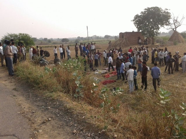 People gather at the site of road accident in Lahar area of Bhind district.