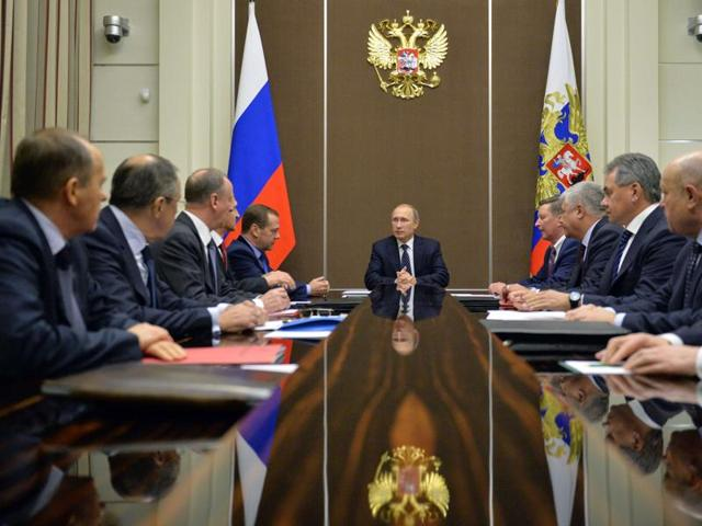 Russian President Vladimir Putin chairs a meeting of the Security Council of the Russian Federation at the Bocharov Ruchei state residence in Sochi.