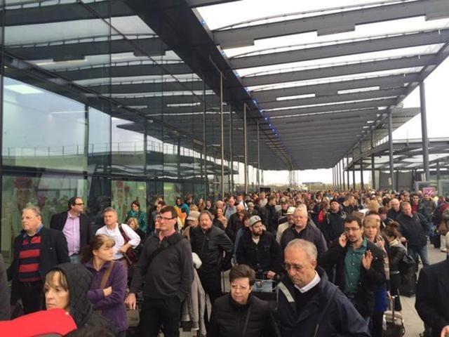 The evacuation process in progress at North Terminal at Gatwick Airport.