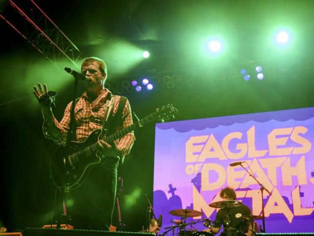 Jesse Hughes of the rock band Eagles of Death Metal performs with drummer Joey Castillo (R) at Festival Supreme at Shrine Auditorium in Los Angeles, California.