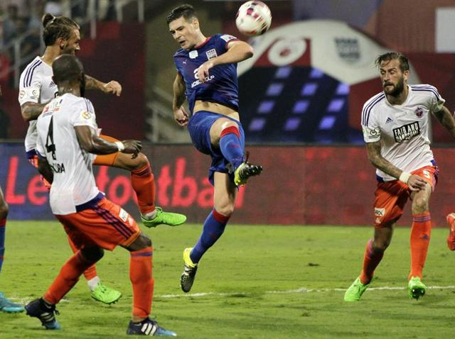 Navi Mumbai: Mumbai City FC (Blue) and FC Pune City players in action during the ISL match at DY Patil Stadium in Navi Mumbai on November 13, 2015.