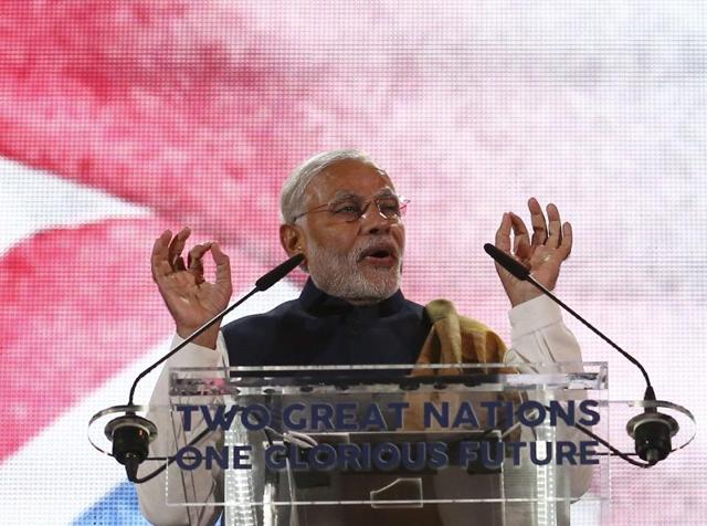 Narendra Modi addresses a welcome rally in his honour at Wembley Stadium in London on Friday.