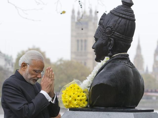 Prime Minister Narendra Modi pays homage at the statue of 12th century Indian philosopher Basaveshwara after unveiling it in London on Saturday.