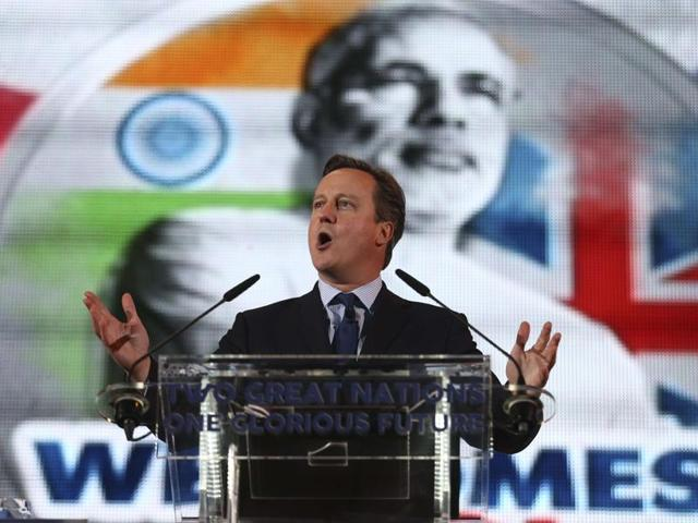 British Prime Minister David Cameron addresses a welcome rally for Prime Minister Narendra Modi at Wembley Stadium, in London.