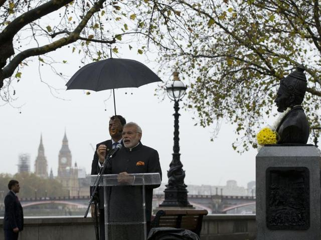 Prime Minister Narendra Modi gives a speech after unveiling a statue of 12th century Indian philosopher Basaveshwara, who was one of the pioneers of the idea of democracy, in London.