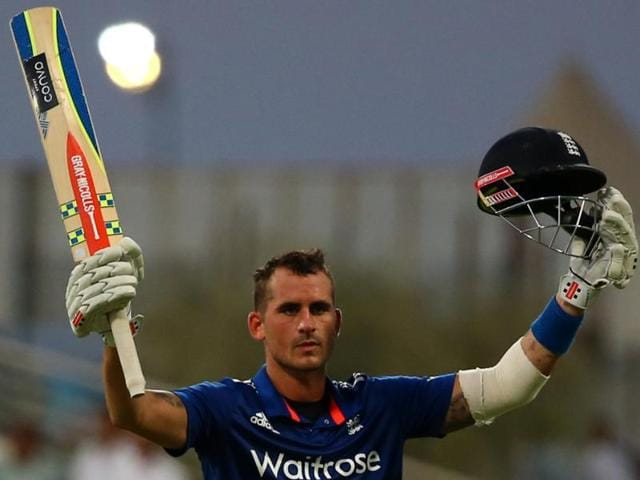 England's Alex Hales (L) with a fist pump to celebrate his century while running between the wickets during the second ODI against Pakistan in Abu Dhabi on November 13, 2015.