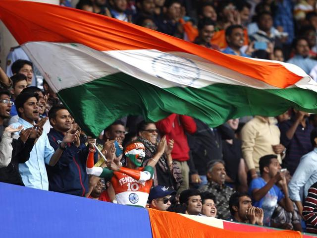 Indian fans cheer during play.