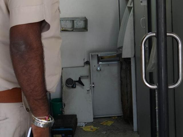 Finger print expert  inspecting the ATM of UCO Bank which was looted in Jalandhar on Saturday.