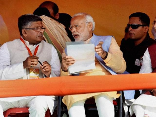 Prime Minister Narendra Modi with Union telecom minister Ravi Shankar Prasad and Union agriculture minister Radha Mohan Singh during an election rally in Darbhanga.