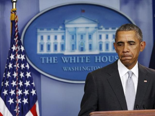 U.S. President Barack Obama pauses while speaking about the shooting attacks in Paris, from the White House in Washington November 13.