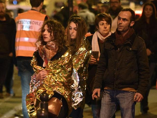 People are evacuated by bus, near the Bataclan concert hall in central Paris, after the deadly attacks.