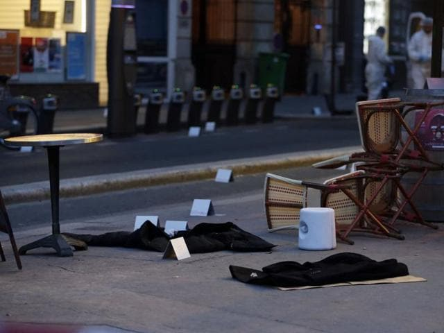 Coats lay on the floor as forensic police search for evidences inside the Comptoir Voltaire cafe at the site of an attack in Paris.