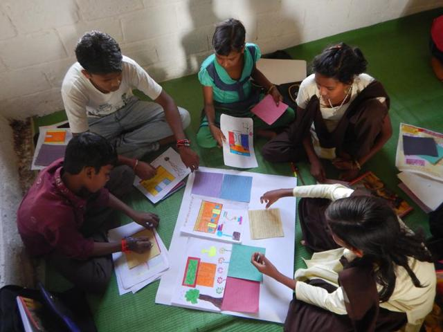 Tribal children from remote Patalkot in Chhindwara district engage in developing material for the wallpaper 'Guiyyan'.