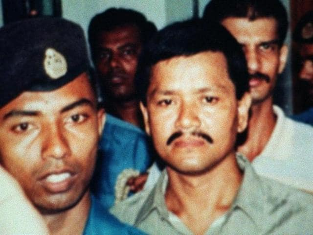 This undated picture shows Anup Kumar Chetia (C), leader of the outlawed United Liberation Front of Assam (ULFA), surrounded by Bangladeshi police as he comes at Dhaka's court.