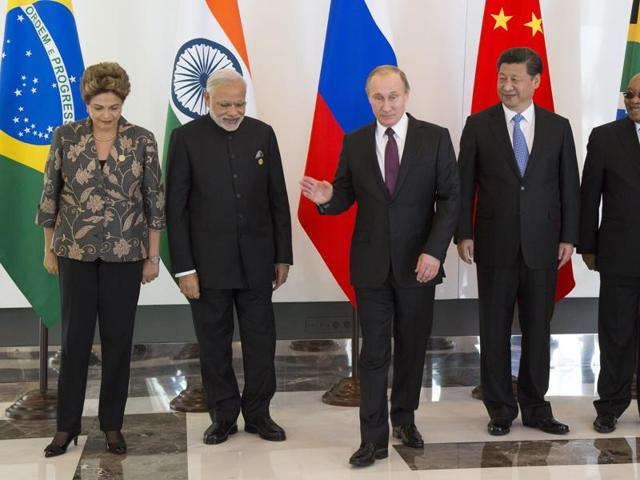 Leaders of BRICS from left, Brazilian President Dilma Rousseff, Indian Prime Minister Narendra Modi, Russian President Vladimir Putin, Chinese President Xi Jinping and South African President Jacob Zuma leave for talks after posing for a photo prior to the G-20 Summit in Antalya, Turkey.