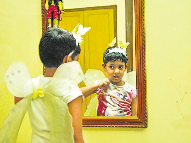 Arora Singhal, 5, from Delhi picked out a Frozen T-shirt, fairy princess hotpants, a butterfly headband and white angel wings to wear for his shoot. He also likes earrings, stoles and flowers in his hair.