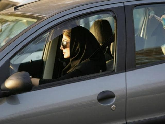 A file picture taken on April 22, 2007, shows an Iranian woman driving her car in the capital Tehran. Iranian women who fail to wear the veil when driving will have their cars impounded for a week and are likely to be fined.