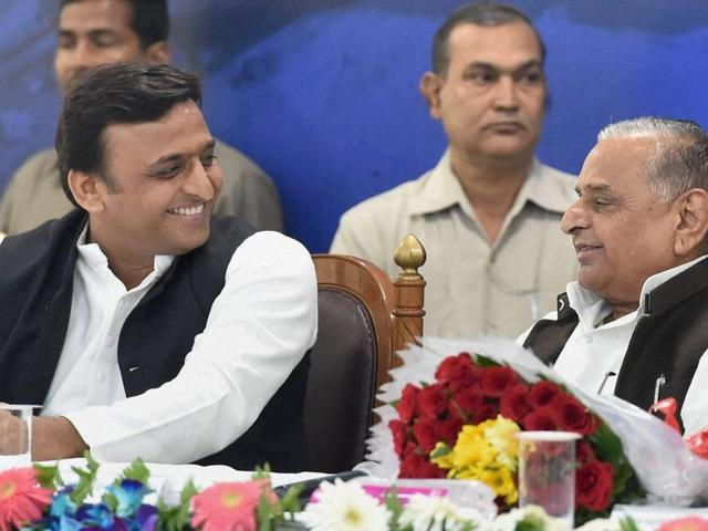 Samajwadi Party president Mulayam Singh Yadav and UP chief minister Akhilesh Yadav at a book release function in Lucknow.