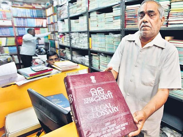 Narendra Jain, son of Lala JM Jain, who started the JM Jaina & Brothers bookstore shows the collection of law books at his bookshop.