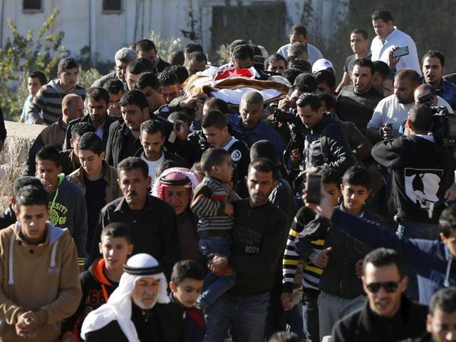 Relatives of Anwar Abu Zeid, the Jordanian officer whom the government said killed five people at a training facility, carry his body during his funeral in Raymun village in the city of Jerash, north of Amman, Jordan.