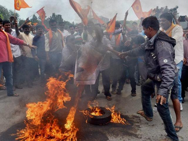 Members of Vishwa Hindu Parishad along with BJP supporters staging a 'rasta roko' protest against the recent violence in Madikeri over Tipu Sultan's Birth anniversary celebrations.