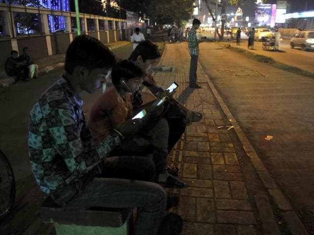 Youngsters glued to their mobile phones at one of the Wi-Fi zones in Indore on Saturday.