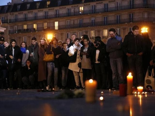 People attend an evening vigil in Place de la Republique following the series of deadly attacks in Paris.