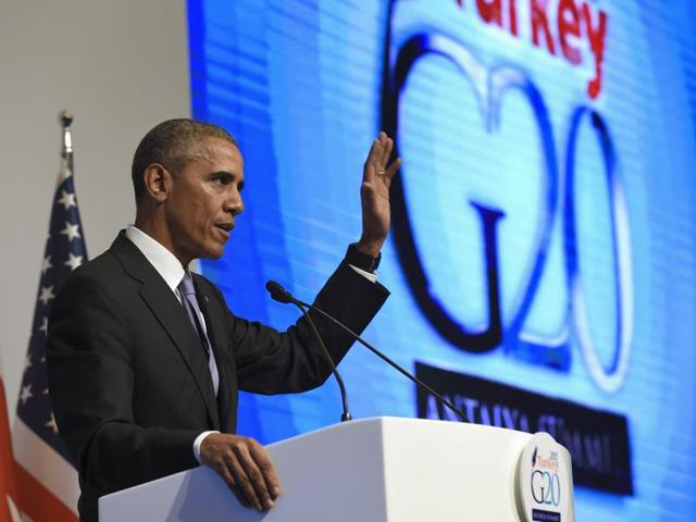 President Barack Obama waves as he concludes his news conference following the G-20 Summit in Antalya.