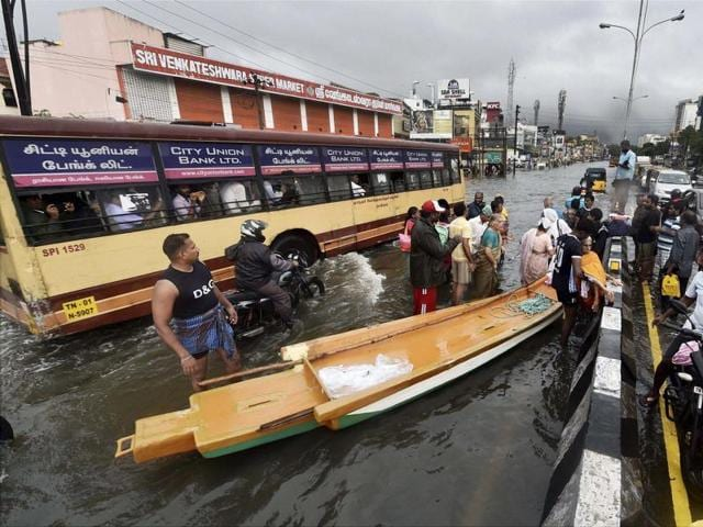 People are rescued by a boat after heavy rains in Chennai on Monday.