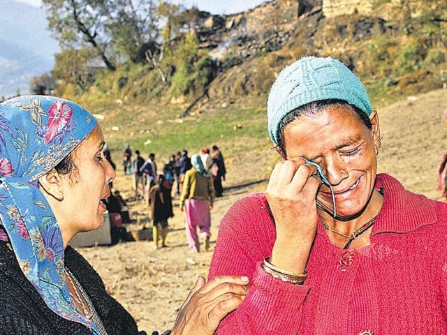 Inconsolable women in Kullu after their houses were gutted in a fire at Kotla village on Sunday.