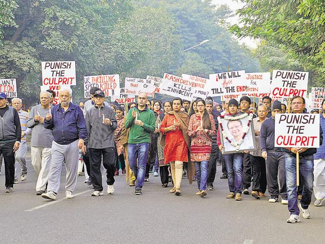 The candlelight march was led by Jatin Virmani's wife Vandana and father Som Nath.