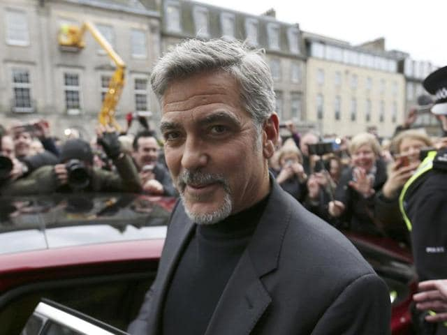 Hollywood actor George Clooney smiles at the shutterbugs near Tiger Liley restaurant in Edinburgh, Scotland.